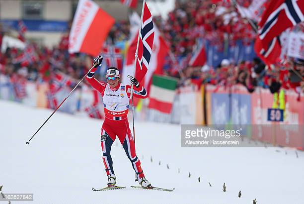 Marit Bjoergen of Norway celebrates victory in the Cross Country Women's Relay at the FIS Nordic World Ski Championships on February 28 2013 in Val...