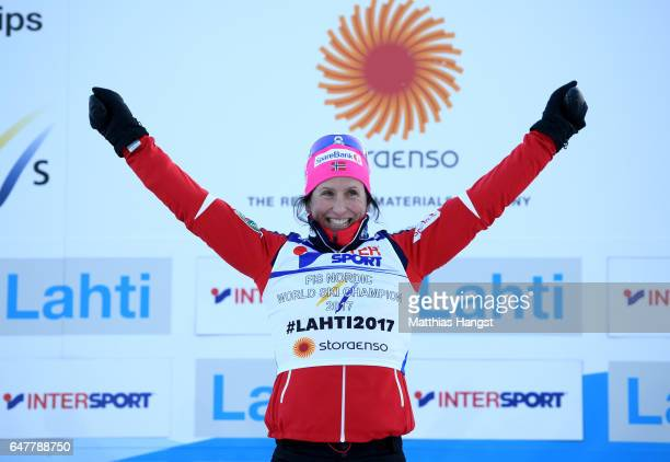 Marit Bjoergen of Norway celebrates victory in the Women's Cross Country Mass Start during the FIS Nordic World Ski Championships on March 4 2017 in...