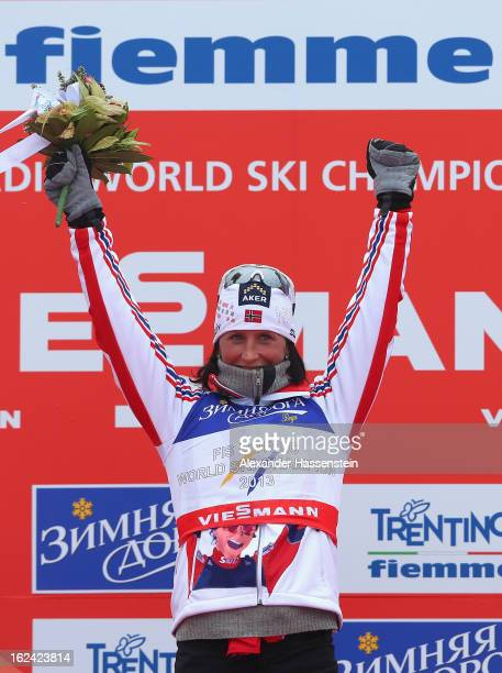 Marit Bjoergen of Norway celebrates victory on the podium after the Women's Skiathlon 7.5km at the FIS Nordic World Ski Championships on February 23,...