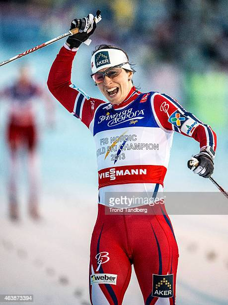Marit Bjoergen of Norway celebrates winning the gold medal at the Ladies 14 km Sprint Classic Finals during the World Championship Cross Country on...