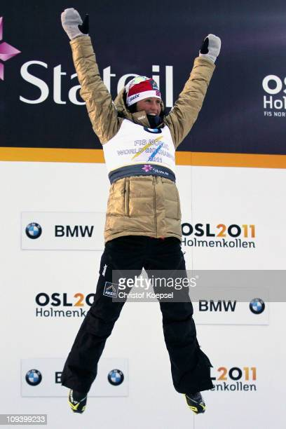 Marit Bjoergen of Norway celebrates winning the gold medal in the flower ceremony following the Ladies Cross Country Sprint race during the FIS...
