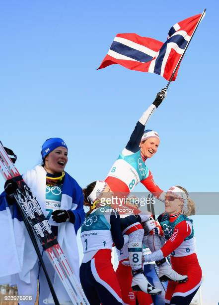 Marit Bjoergen of Norway celebrates winning the Ladies' 30km Mass Start Classic on day sixteen of the PyeongChang 2018 Winter Olympic Games at...