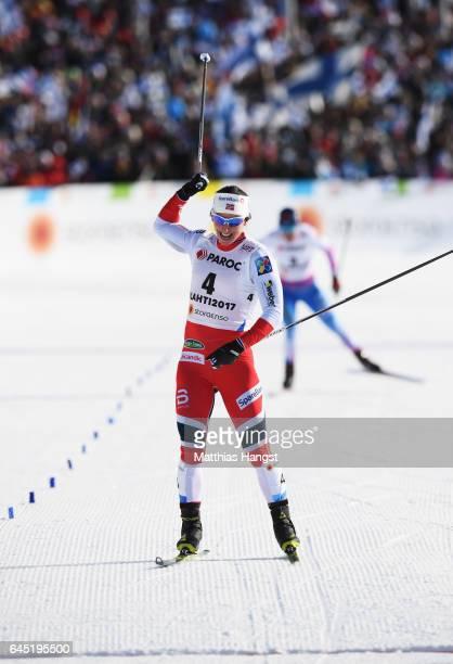 Marit Bjoergen of Norway celebrates winning the Women's Cross Country Skiathlon during the FIS Nordic World Ski Championships on February 25 2017 in...