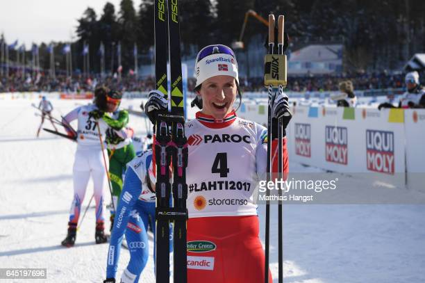 Marit Bjoergen of Norway celebrates winning the Women's Cross Country Skiathlon during the FIS Nordic World Ski Championships on February 25 2017 in...