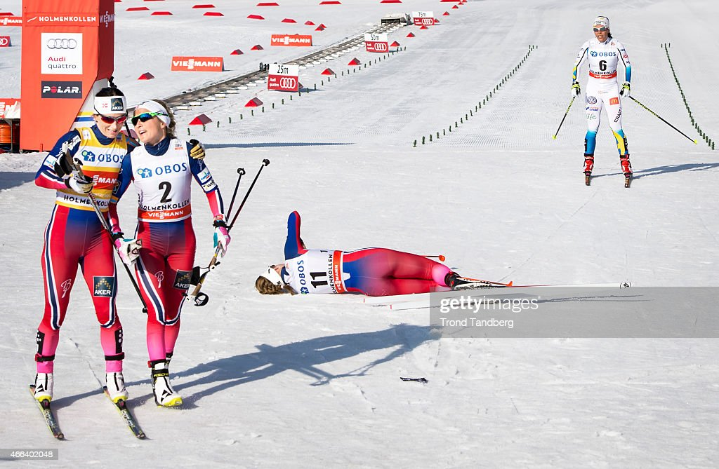 Marit Bjoergen of Norway celebrates winning with Therese ...