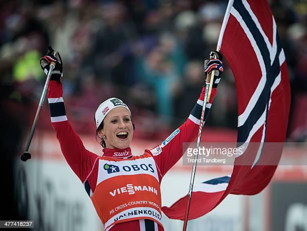 Marit Bjoergen of Norway celebrates with the Norwegian Flag after her win during the FIS Cross-Country World Cup Ladies 30 km Mass Start Classic on...