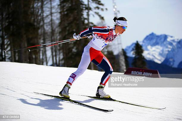 Marit Bjoergen of Norway competes during the Women's 30 km Mass Start Free during day 15 of the Sochi 2014 Winter Olympics at Laura Cross-country Ski...