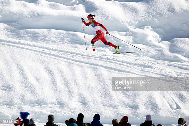 Marit Bjoergen of Norway competes during the Women's CrossCountry Individual Sprint C Final on day 6 of the 2010 Vancouver Winter Olympics at...