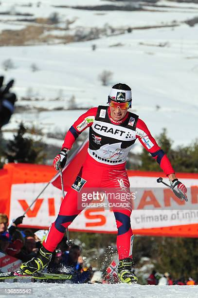 Marit Bjoergen of Norway competes to take the second place during the women's nine km free final climb pursuit start race nine of the Tour de Ski in...