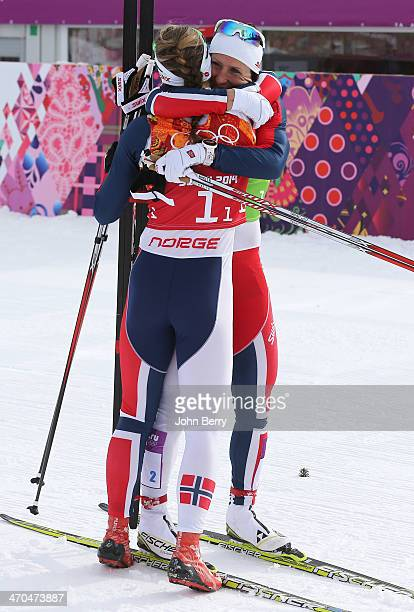 Marit Bjoergen of Norway is joined by her teammate Ingvild Flugstad Oestberg after crossing the finish line as winners after the Women's Team Sprint...