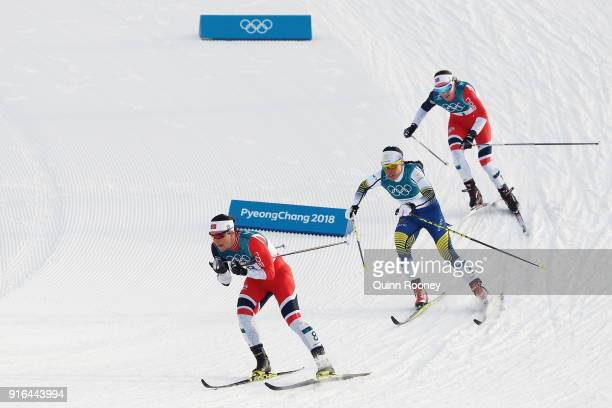 Marit Bjoergen of Norway leads Charlotte Kalla of Sweden and Heidi Weng of Norway during the Ladies Cross Country Skiing 75km 75km Skiathlon on day...