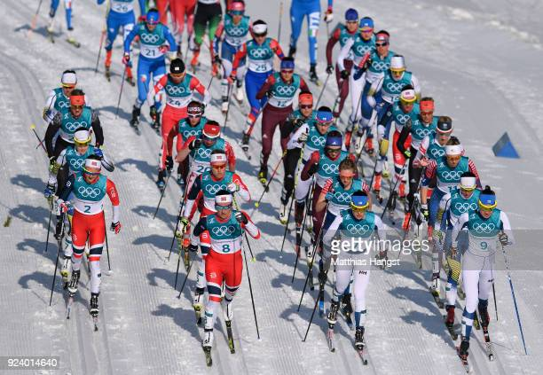 Marit Bjoergen of Norway leads the field during the Ladies' 30km Mass Start Classic on day sixteen of the PyeongChang 2018 Winter Olympic Games at...