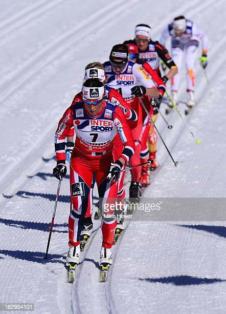 Marit Bjoergen of Norway leads the pack on her way to victory during the Women's Cross Country Mass Start 30Km at the FIS Nordic World Ski...