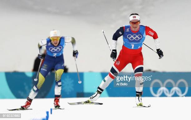 Marit Bjoergen of Norway races to the finish line to win gold ahead of Stina Nilsson of Sweden during the Ladies' 4x5km Relay on day eight of the...