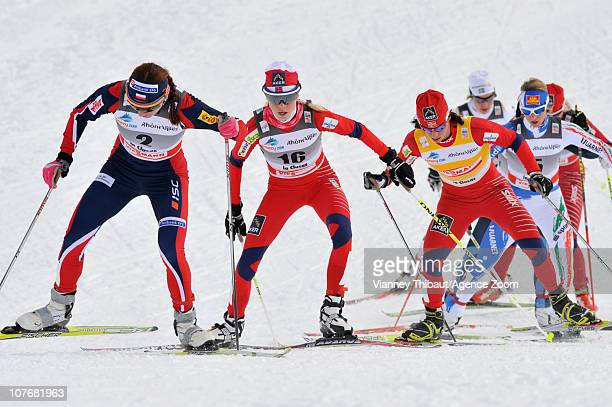 Marit Bjoergen of Norway skies to 1st place Justyna Kowalczyk of Poland 2nd place and Kristin Stoermer Steira of Norway takes 3rd place during the...