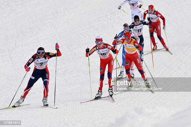 Marit Bjoergen of Norway skis on her way to taking 1st place ahead of Justyna Kowalczyk of Poland in 2nd place and Kristin Stoermer Steira of Norway...