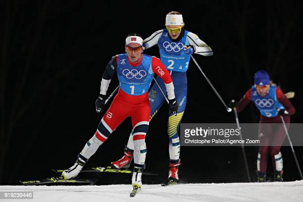 Marit Bjoergen of Norway Stina Nilsson of Sweden in action during the CrossCountry Women's Relay at Alpensia CrossCountry Centre on February 17 2018...