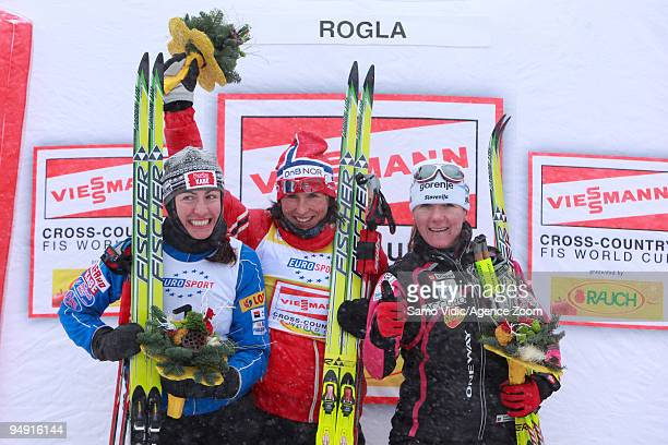 Marit Bjoergen of Norway takes 1st place Justyna Kowalczyk of Poland takes 2nd place Petra Majdic of Slovenia takes 3rd place during the Viessman...