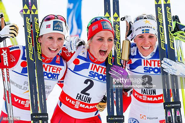 Marit Bjoergen of Norway takes 2nd place, Therese Johaug of Norway takes 1st place, Charlotte Kalla of Sweden takes 3rd place during the FIS Nordic...