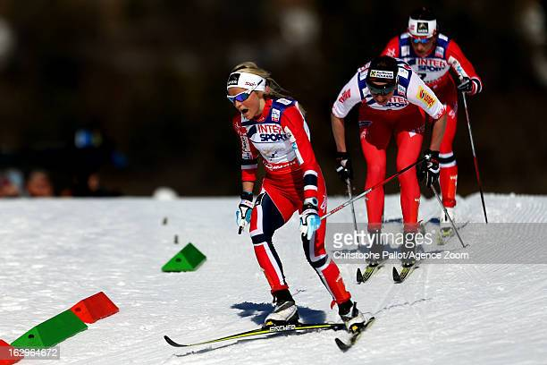 Marit Bjoergen of Norway takes the gold medal Justyna Kowalczyk of Poland takes the silver medal Therese Johaug of Norway takes the bronze medal...