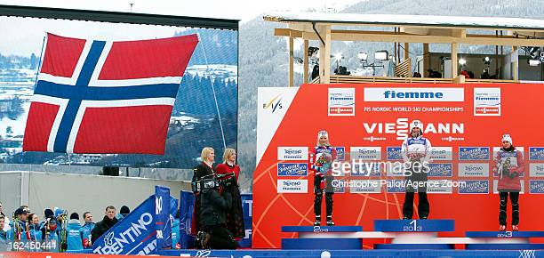 Marit Bjoergen of Norway takes the gold medal Therese Johaug of Norway takes the silver medal Heidi Weng of Norway takes the bronze medal at the FIS...