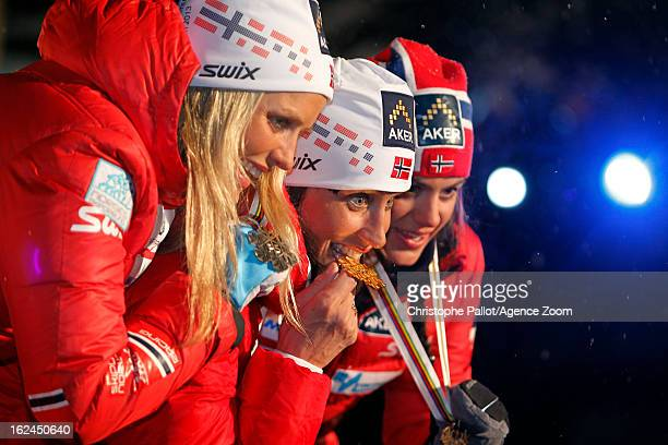 Marit Bjoergen of Norway takes the gold medal Therese Johaug of Norway takes the silver medal Heidi Weng of Norway takes the bronze medal during the...