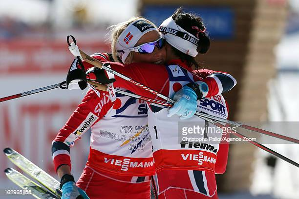 Marit Bjoergen of Norway takes the gold medal Therese Johaug of Norway takes the bronze medal during the FIS Nordic World Ski Championships Cross...