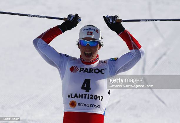 Marit Bjoergen of Norway wins the gold medal during the FIS Nordic World Ski Championships Men's and Women's Cross Country Skiathlon on February 25...