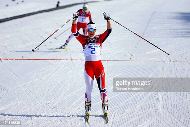 Marit Bjoergen of Norway wins the Women's 30 km Mass Start Free during day 15 of the Sochi 2014 Winter Olympics at Laura Crosscountry Ski Biathlon...