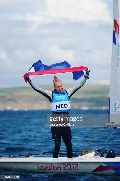 Marit Bouwmeester of Netherlands celebrates after winning silver medal in the Laser Radial Women's Sailing on Day 10 of the London 2012 Olympic Games...