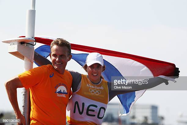 Marit Bouwmeester of the Netherlands celebrates winning the gold medal in the Women's Laser Radial class on Day 11 of the Rio 2016 Olympic Games at...