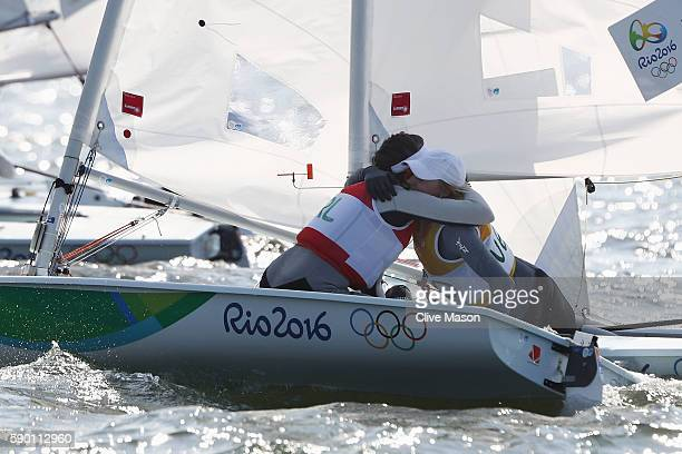 Marit Bouwmeester of the Netherlands celebrates winning the gold medal with silver medal winner Annalise Murphy of Ireland following the Women's...
