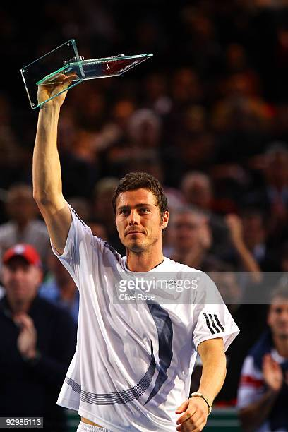 Marit Safin of Russia holds aloft his award after playing his final competitive match against Juan Martin Del Potro of Argentina during the ATP...
