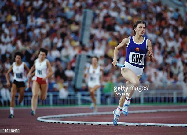 Marita Koch of East Germany carrying the baton during the Women's 4 × 400 metres Relay event on 1st August 1980 at the XXII Summer Olympics Games in...