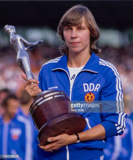 Marita Koch of East Germany holds the trophy after the DDR won both the men's and women's European Cup of Athletics on 20th August 1983 at the...