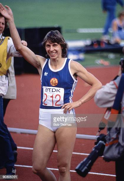 Marita Koch of East Germany winner of the women's 200m final at the 1st World Athletics Championships held at the Olympic Stadium in Helsinki Finland...
