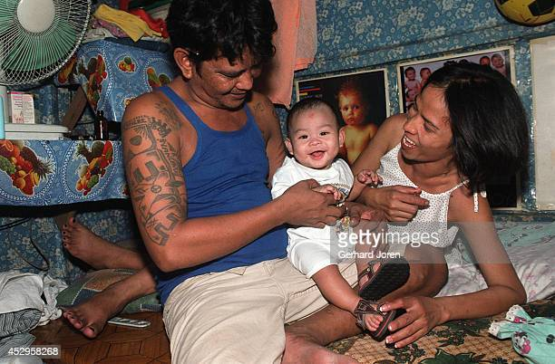 Marites Biado with her husband Henry and their son Prince Henry, inside their cell barrack at Manila City Jail. Marites lives inside the jail with...