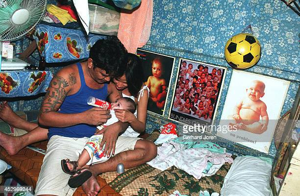Marites Biado with her husband Henry and their son Prince Henry inside their cell barrack at Manila City Jail Marites lives inside the jail with her...