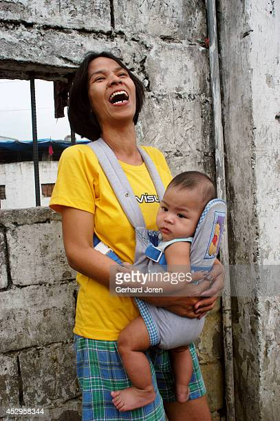 Marites Biado with her son Prince Henry inside Manila City Jail. Marites lives inside the jail with her husband Henry, who is waiting for his murder...