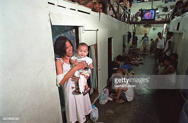 Marites Biado with her son Prince Henry, inside their cell barrack at Manila City Jail. Marites lives inside the jail with her husband Henry, who is...