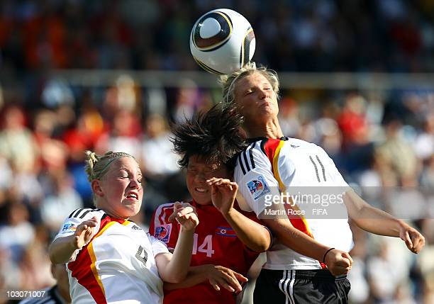 Marith Priessen Alexandra Popp of Germany and Hyon Hi Yun of North Korea head for the ball during the FIFA U20 Women's World Cup Quarter Final match...