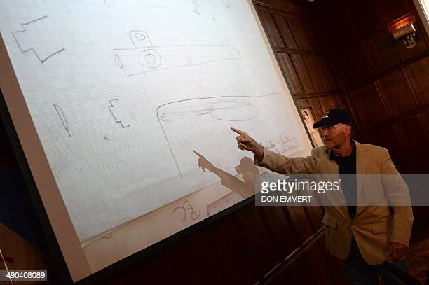 Maritime archaeological investigator Barry Clifford points to a diagram as he talks about discovering what he believes to be Christopher Columbus'...
