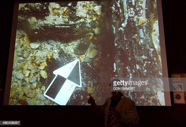 Maritime archaeological investigator Barry Clifford uses slides as he talks about discovering what he believes to be Christopher Columbus' ship the...