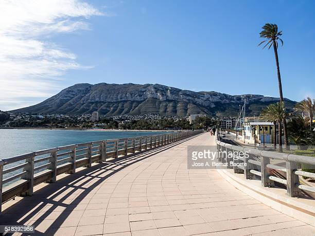 maritime walk close to the sea of denia's city - denia stock pictures, royalty-free photos & images