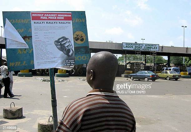 A maritime worker reads a poster mobilising workers for strike at the main entrance leading to the Lagos Apapa port 02 July 2003 Economic activities...