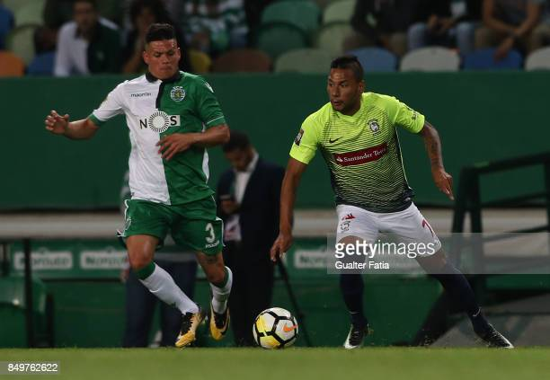 Maritimo forward Ibson from Brazil with Sporting CP defender Jonathan Silva from Argentina in action during the Portuguese League Cup match between...