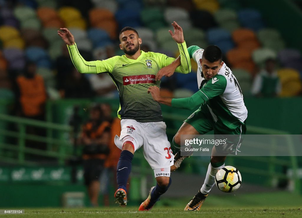 CS Maritimo forward Ricardo Valente from Portugal tackled by Sporting CP midfielder Rodrigo Battaglia from Argentina during the Portuguese League Cup match between Sporting CP and CS Maritimo at Estadio Jose Alvalade on September 19, 2017 in Lisbon, Portugal.
