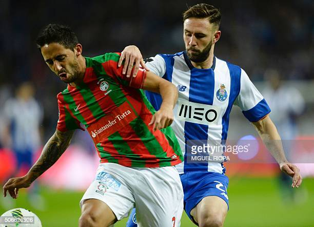Maritimo Funchal's defender Joao Diogo vies with Porto's Mexican defender Miguel Layun during the Portuguese league football match FC Porto vs CS...