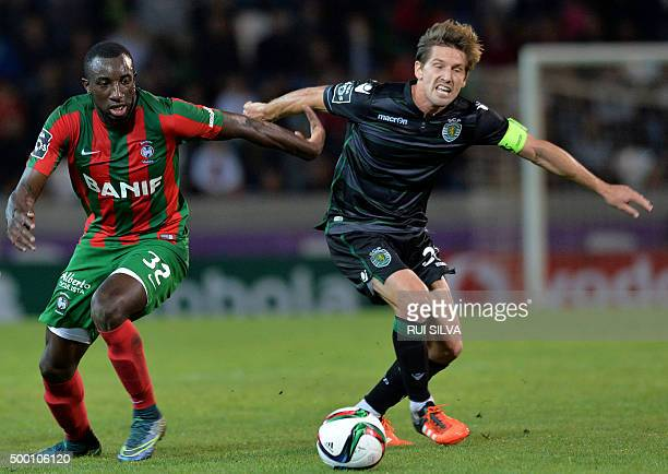 Maritimo Funchal's French forward Moussa Marega vies with Sporting's midfielder Adrien Silva during the Portuguese league football match CS Maritimo...