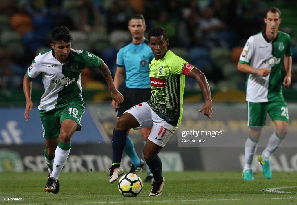 CS Maritimo midfielder Eber Bessa from Brazil with Sporting CP forward Alan Ruiz from Argentina in action during the Portuguese League Cup match between Sporting CP and CS Maritimo at Estadio Jose Alvalade on September 19, 2017 in Lisbon, Portugal.